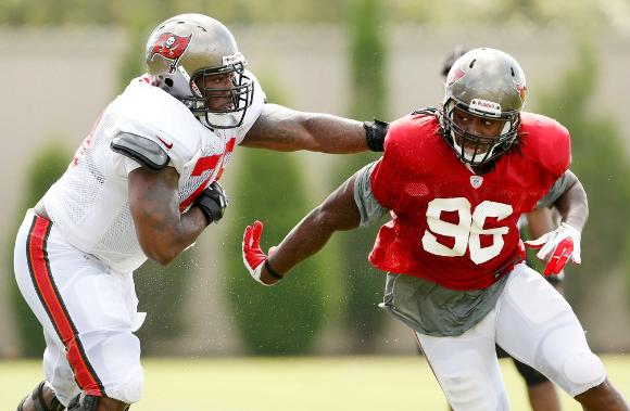 Rookie defensive end Steven Means, right, gets past Pro Bowl left tackle Donald Penn in a recent Bucs practice.
