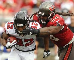 Adrian Clayborn takes down Dixie Chicks running back Jacquizz Rodgers.