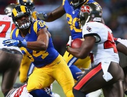 Robert Quinn of the Rams tracks down Bucs running back Bobby Rainey. The disgraceful way Rainey was misused likely sealed Mike Sullivan's fate as Bucs offensive coordinator.