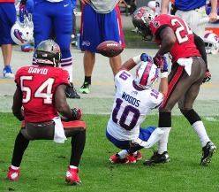 The ball pops free of Buffalo wide receiver Robert Woods after getting blasted by Bucs corner Darrelle Revis late in the third quarter Sunday.