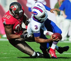 Bucs defensive lineman Will Gholston drags down Buffalo quarterback EJ Manuel.