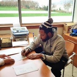 Former Bucs sackmeister and current Seattle DE Michael Bennett Twittered out this photo of his signing a contract extension with the Super Bowl champs this afternoon.