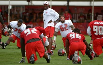 Bucs coach Lovie Smith stands among his players during warm-ups yesterday