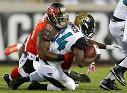 Bucs DT Da'Quan Bowers buries Jags RB Storm Johnson for a loss Friday. Photo courtesy of Buccaneers.com.