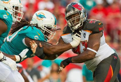 Bucs DT Gerald McCoy, who said the defensive line needs to improve, puts a move on a Dolphins offensive lineman last night. Photo courtesy of Buccaneers.com.