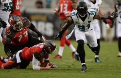 Jaguars DE Chris Clemons celebrates putting Bucs QB Josh McCown on the ground Friday.