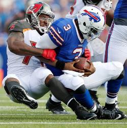 Bucs DL Larry English brings Bills QB E.J. Manuel to the turf for one of his two sacks today. Photo courtesy of Buccaneers.com.