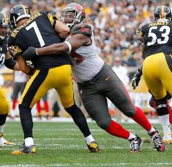 Bucs DT Gerald McCoy blasts Steelers QB Ben Roethlisberger for one of the Bucs' five sacks today.