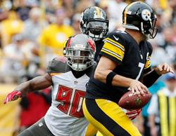 Bucs DE Michael Johnson chases down Steelers QB Ben Roethlisberger for one of his two sacks today. Photo courtesy of Buccaneers.com.