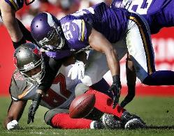 Vikings LB Anthony Barr picks up a fumble from Bucs TE Austin Seferian-Jenkins for the game-winning play Sunday.