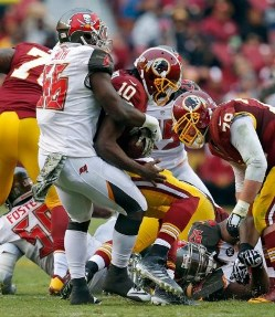 Jacquies Smith brings down Redskins QB Robert Griffin III.