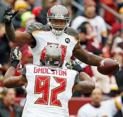 Danny Lansanah and Will Gholston celebrate an interception early in the game that helped the Bucs jump out to an early lead against the Redskins.
