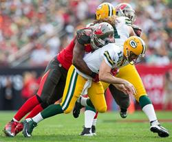 Bucs DE Michael Johnson blasts Packers QB Aaron Rodgers in the first half.