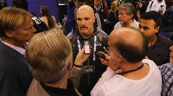 Seahawks DC Dan Quinn, believed to be the new Dixie Chicks coach, is mobbed by reporters yesterday at Super Bowl media day.