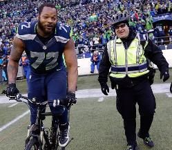 Seahawks DE Michael Bennett -- who the Bucs let walk away for no good reason -- ride's a cop's bike in glee after defeating the Packers in the NFC title game last week. Joe hopes to talk to him tomorrow.