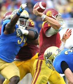 How would UCLA DE Owamagbe Odighizuwa look in pewter and red?