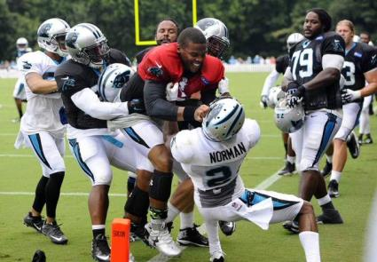 Stinking Panthers QB Cam Newton goes mental after throwing a pick in practice today.