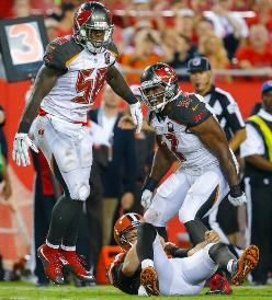 Bucs MLB Kwon Alexander (58) and OLB Lavonte David react to Alexander flattening Browns QB Josh McClown last night. Photo courtesy of Buccaneers.com.