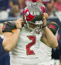 Bucs K Kyle Brindza hangs his head after one of his four misses yesterday. Lovie Smith had his back.