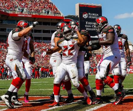Doug Martin (22) and his Bucs teammates celebrate a touchdown yesterday in the win over the Jags. (Photo courtesy of Buccaneers.com.)