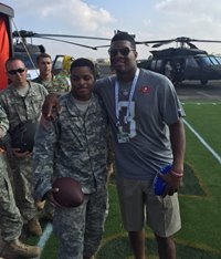 America's Quarterback hangs with America's Finest in Hawaii.
