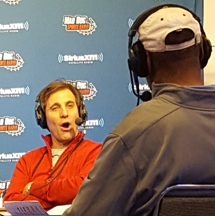 "The one and only Chris ""Mad Dog"" Russo talks to former Dolphins TE Marv Fleming on radio row."