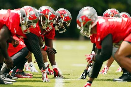 Fingers on the line at the first Bucs practice under head coach Dirk Koetter Tuesday at One Buc Palace. (Photo Courtesy of Buccaneers.com.)